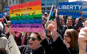Demonstrators gather at Monument Circle to protest a controversial religious freedom bill recently signed by Governor Mike Pence during a rally in Indianapolis March 28, 2015.  More than 2,000 people gathered at the Indiana State Capital Saturday to protest Indiana?s newly signed Religious Freedom Restoration Act saying it would promote discrimination against individuals based on sexual orientation.  REUTERS/Nate Chute - RTR4VA8L